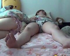 Asian teens dowsing bed