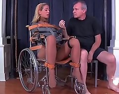 Blonde milf cherie deville constrained gagged in a straitjacket and wheelchair therapy