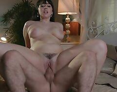 Dark haired bimbo with big natural tits enjoys rough pounding